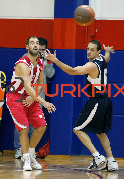 Efes Pilsen's Igor RAKOCEVIC (R) during their friendly basketball match Efes Pilsen between Olympiacos at Efes Pilsen Arena in Istanbul, Turkey, Sunday, October 03, 2010. Photo by TURKPIX