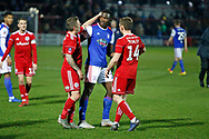 Accrington Stanley midfielder Scott Brown (8) and Accrington Stanley midfielder Sam Finley (14) commiserate with Ipswich Town defender Aristote Nsiala (22)  during the The FA Cup 3rd round match between Accrington Stanley and Ipswich Town at the Fraser Eagle Stadium, Accrington, England on 5 January 2019.