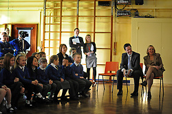 © Licensed to London News Pictures. 27/01/2012, Solihull, UK. A film, made by the children, is shown to the visitors. NICK CLEGG (seated right) the British Deputy Prime Minister and Liberal Democrat leader is joined by Member of Parliament for Solihull LORLEY BURT (seated Left) at Peterbrook Primary School, Solihull, to see how the local primary school is using its Pupil Premium money. 27th January 2012.   Photo credit : Stephen Simpson/LNP