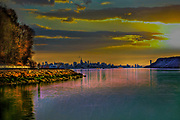 Hudson River looking at the skyline of New York City at dusk.