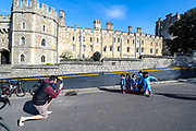 A man photographs his children outside Windsor Castle after the death of Britain's Prince Philip in Windsor on Sunday, April 11, 2021. Britain's Prince Philip, the irascible and tough-minded husband of Queen Elizabeth II who spent more than seven decades supporting his wife in a role that most defined his life, died on Friday. (Photo/ Vudi Xhymshiti)