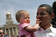 IOWA CITY, IA  - APRIL 22: Democratic presidential hopeful and Sen. Barack Obama, D-IL, holds 10-month-old Claire Von Bergen of Iowa City while shaking hands with supporters after speaking Sunday, April 22, 2007 on the Pentacrest at the University of Iowa in Iowa City, Iowa. The Senator as part of an Earth Day celebration on the campus. (Photo by Scott Morgan/Getty Images)
