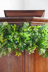Church flower arrangement. Pulpit  showing foliage