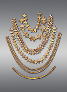 Mycenaean gold necklaces from the Mycenae chamber tombs, Greece. National Archaeological Museum Athens. Grey Background<br /> <br /> From top to bottom: <br /> <br /> Top four  necklaces in the shape of papyrus flowers .<br /> <br /> Fifth necklace down in the shape of Ivy leaves from tomb 91 Cat No 3186<br /> <br /> <br /> Bottom necklace with beads in the shape of hangimng scrolls from tomb 25 Cat No 2478. .<br /> <br /> If you prefer to buy from our ALAMY PHOTO LIBRARY  Collection visit : https://www.alamy.com/portfolio/paul-williams-funkystock/mycenaean-art-artefacts.html . Type -   Athens    - into the LOWER SEARCH WITHIN GALLERY box. Refine search by adding background colour, place, museum etc<br /> <br /> Visit our MYCENAEN ART PHOTO COLLECTIONS for more photos to download  as wall art prints https://funkystock.photoshelter.com/gallery-collection/Pictures-Images-of-Ancient-Mycenaean-Art-Artefacts-Archaeology-Sites/C0000xRC5WLQcbhQ