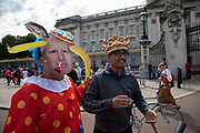 Anti Brexit protester dressed up as a clown version of Prime Minister Boris Johnson hires a Boris bike in Westminster and cycles to Buckingham Palace as it is announced that Boris Johnson has had his request to suspend Parliament approved by the Queen on 28th August 2019 in London, England, United Kingdom. The announcement of a suspension of Parliament for approximately five weeks ahead of Brexit has enraged Remain supporters who suggest this is a sinister plan to stop the debate concerning a potential No Deal.