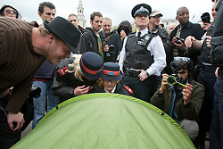 © licensed to London News Pictures. London, UK 01/05/2012. Heritage Wardens, police officers and May Day protesters looking at a tent as protesters set tents to Trafalgar Square after the march, today (01/05/12). Photo credit: Tolga Akmen/LNP