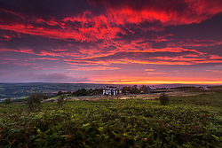 © Licensed to London News Pictures. 07/09/2020. Ilkley UK. The sky is turned red at dawn this morning above the Cow & Calf pub on Ilkley Moor in Yorkshire. Photo credit: Andrew McCaren/LNP