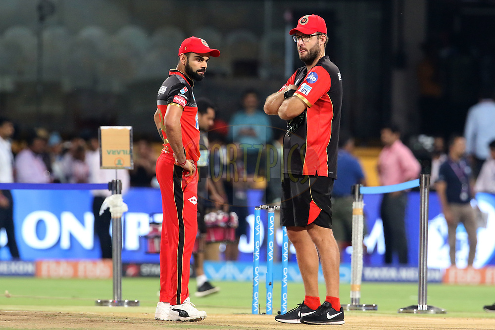 Virat Kohli captain of the Royal Challengers Bangalore and Daniel Vettori coach of the Royal Challengers Bangalore before the start of the match fifty one of the Vivo Indian Premier League 2018 (IPL 2018) between the Royal Challengers Bangalore and the Sunrisers Hyderabad held at the M. Chinnaswamy Stadium in Bangalore on the 17th May 2018.<br /> <br /> Photo by: Vipin Pawar /SPORTZPICS for BCCI