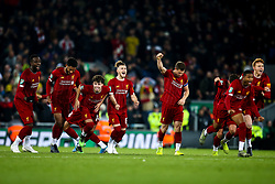 Liverpool players celebrate as Curtis Jones of Liverpool scores the winning penalty in the shootout against Arsenal - Mandatory by-line: Robbie Stephenson/JMP - 30/10/2019 - FOOTBALL - Anfield - Liverpool, England - Liverpool v Arsenal - Carabao Cup