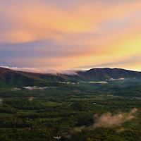 """""""Sunset in the Valley""""<br /> <br /> Beautiful low clouds pass through and on the mountains as pastel hued skies make the transition from day to sunset!!<br /> <br /> The Blue Ridge Mountains by Rachel Cohen"""