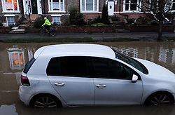 © Licensed to London News Pictures. 29/12/15<br /> York, UK. <br /> <br /> A man cycles along the pavement as flood water begins to subside on Huntington Road in York. Further rainfall is expected over coming days as Storm Frank approaches the east coast of the country.<br /> <br /> Photo credit : Ian Forsyth/LNP