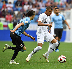 France's Kylian Mbappe and Uruguay's Diego Laxalt during the FIFA World Cup 2018 Round of 8 France v Uruguay match at the Nizhny Novgorod Stadium Russia, on July 6, 2018. France won 2-0. Photo by Christian Liewig/ABACAPRESS.COM
