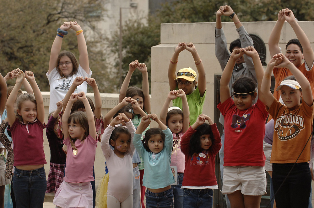 Austin, TX March 4, 2006: Children learn a traditional Indian dance called Bharatnatyam,  at Expore UT, the annual open house for the college campus at the University of Texas. <br /> ©Bob Daemmrich