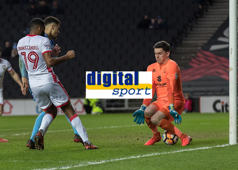 Football - 2017 / 2018 FA Cup - Fourth Round: Milton Keynes Dons vs. Coventry City<br /> <br /> Maxime Biamou (Coventry City) gets a foot to the ball and guides it through the legs of Lee Nicholls (MK Dons) at the Stadium MK.<br /> <br /> COLORSPORT/DANIEL BEARHAM