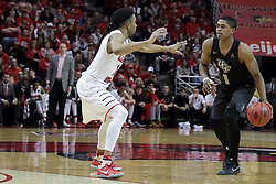 20 March 2017:  B.J. Taylor approaches the three point line protected by Tony Wills(12) during a College NIT (National Invitational Tournament) 2nd round mens basketball game between the UCF (University of Central Florida) Knights and Illinois State Redbirds in  Redbird Arena, Normal IL