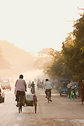 Commuter traffic early in the morning along the streets of Mandalay, Myanmar