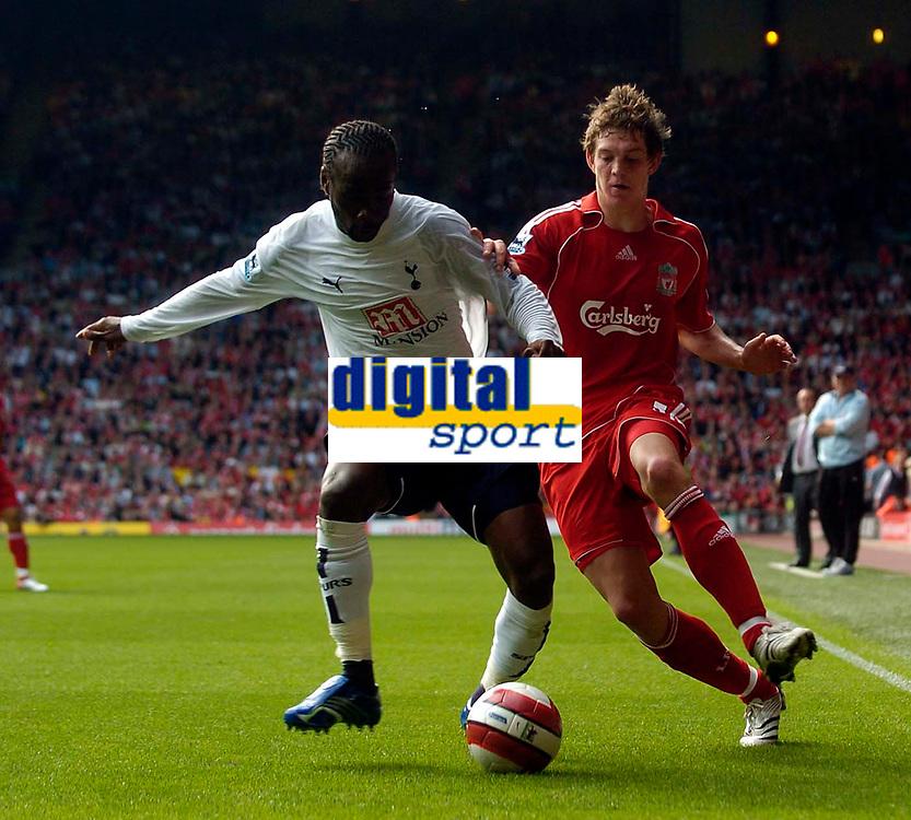 Photo: Jed Wee.<br />Liverpool v Tottenham Hotspur. The Barclays Premiership. 23/09/2006.<br /><br />Liverpool's Daniel Agger (R) pressures Tottenham's Pascal Chimbonda.