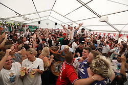 Fans celebrate at the Rose & Crown pub, in Wimbledon, south London as England qualify for the World Cup semi-final after beating Sweden 2-0 in Russia.