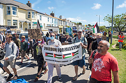 © Licensed to London News Pictures; 12/06/2021; Hayle, Cornwall UK. G7 summit in Cornwall. The Resist G7 coalition of protest groups hold a protest in Hayle on the second day of the G7 summit. The protest included supporters of Palestine and of Kashmir as well as anti-war groups and socialists and trade unionists. Photo credit: Simon Chapman/LNP.