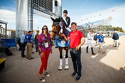 ROTHENBERGER Sönke (GER), Cosmo, ROTHENBERGER Gonnelien, ROTHENBERGER Sven<br /> Tryon - FEI World Equestrian Games™ 2018<br /> Backgroundbilder vom Abreiteplatz<br /> Grand Prix de Dressage Teamwertung und Einzelqualifikation<br /> 13. September 2018<br /> © www.sportfotos-lafrentz.de/Sharon Vandeput