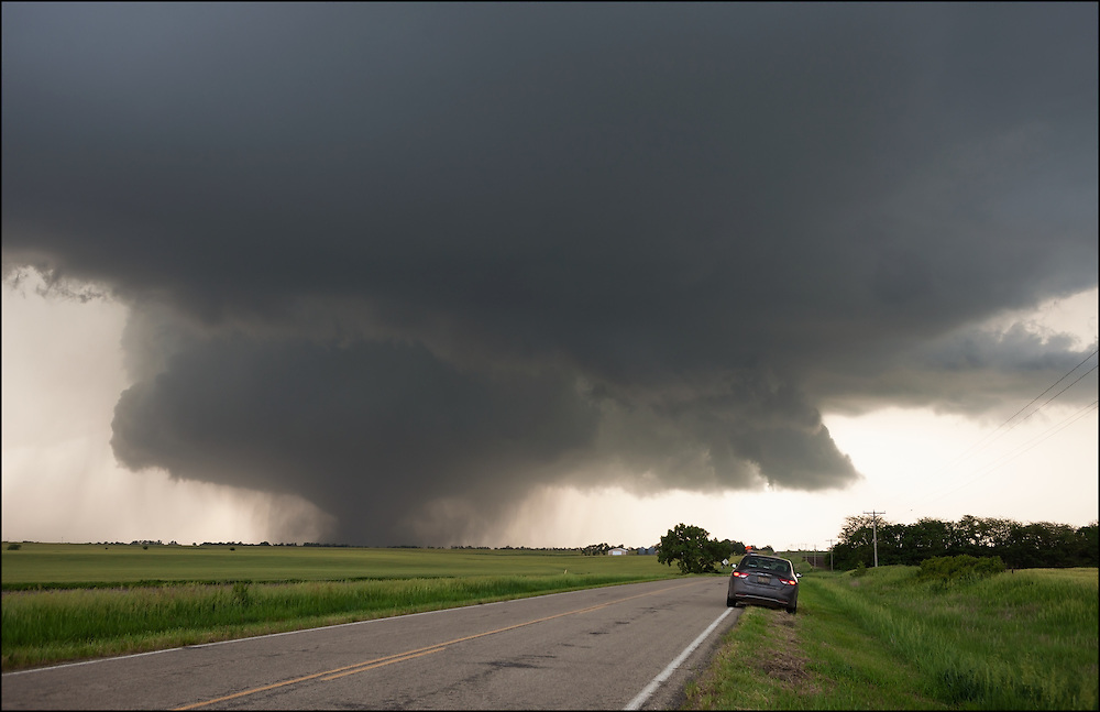 Tornado with classic structure turning up a field  in North Central Kansas.