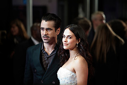 © Licensed to London News Pictures. 13/02/2014. London, UK. Colin Farrell (L) and Jessica Brown Findlay as they attend during A New York Winter's Tale premiere outside the Odeon Kensington. Photo credit : Andrea Baldo/LNP