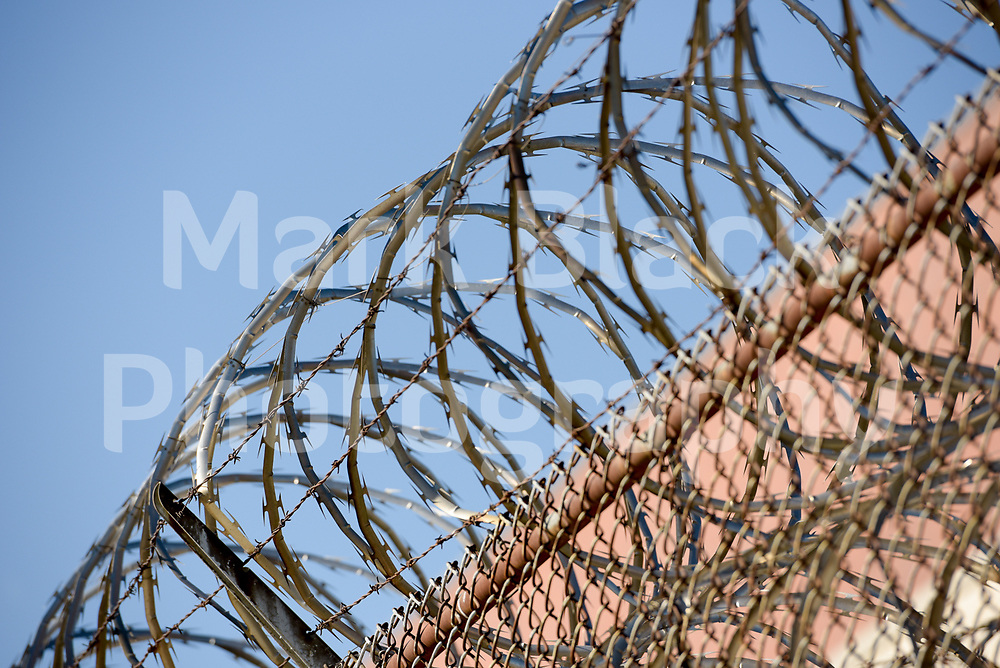 Razor wire on the wall at Cook County Department of Corrections Jail near 26th and California in Chicago on Wednesday, Aug. 19, 2020.  Photo by Mark Black