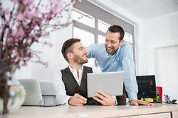 Two men planning meeting tablet computer
