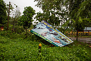 'Indo Tibetan Boarder Police ITBP A Force To Be Reckon With' sign which has been blown over in a recent storm on 20th September 2018 in Guwahati, Assam, India.