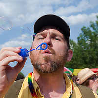 Participant of the Gay Pride March blows soap bubbles in Budapest, Hungary on June 18, 2011. ATTILA VOLGYI