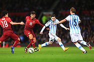 Andre Gomes of Portugal and Lionel Messi of Argentina in action - Argentina vs. Portugal - International Friendly - Old Trafford - Manchester - 18/11/2014 Pic Philip Oldham/Sportimage