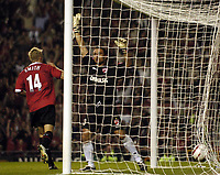Photo. Jed Wee.<br /> Manchester United v Dinamo Bucharest, UEFA Champions League Qualifying 2nd Leg, 24/08/2004.<br /> Dinamo goalkeeper Cristi Munteanu (R) can only appeal in vain for offside as Alan Smith runs off to celebrate a disputed goal