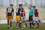 Cambridge United Striker Jimmy Spencer is yellow carded  during the Sky Bet League 2 match between Northampton Town and Cambridge United at Sixfields Stadium, Northampton, England on 12 March 2016. Photo by Dennis Goodwin.