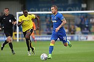 AFC Wimbledon midfielder Dean Parrett (18) dribbling and on the attack during the Pre-Season Friendly match between AFC Wimbledon and Burton Albion at the Cherry Red Records Stadium, Kingston, England on 21 July 2017. Photo by Matthew Redman.
