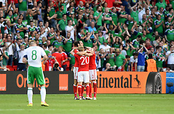 Gareth Bale of Wales celebrates  on the final whistle with Jonathan Williams of Wales and Chris Gunter of Wales  - Mandatory by-line: Joe Meredith/JMP - 25/06/2016 - FOOTBALL - Parc des Princes - Paris, France - Wales v Northern Ireland - UEFA European Championship Round of 16