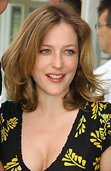 Actress GILLIAN ANDERSON at the Queen's Cup polo final sponsored by Cartier at Guards Polo Club, Smith's Lawn, Windsor Great Park on 18th June 2006.  The Final was between Dubai and the Broncos polo teams with Dubai winning.<br /><br />NON EXCLUSIVE - WORLD RIGHTS