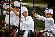 Boys prepare for a Hindu religious festival in Ubud, Bali, Indonesia.