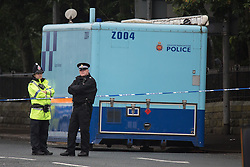 "© Licensed to London News Pictures. 27/07/2015. Salford, UK. Mobile police station outside the home of Paul Massey on Manchester Road , Clifton , Salford where Paul Massey - known as Salford's ""Mr Big"" was shot dead last night (26th July 2015 ) . Photo credit: Joel Goodman/LNP"