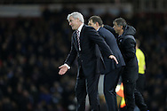 Mark Hughes, the Stoke City manager shouting at his players as he urges them forward. Barclays Premier league match, West Ham Utd v Stoke city at the Boleyn Ground, Upton Park  in London on Saturday 12th December 2015.<br /> pic by John Patrick Fletcher, Andrew Orchard sports photography.