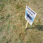 A poster stuck into the ground promoting a book during the bi-annual aerospace industry expo at the Farnborough airshow, about the Concorde supersonic airliner, on the day an Air France Concorde crashed outside Paris on 25th July 2002.