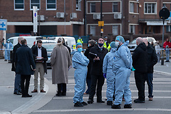 © Licensed to London News Pictures. 08/03/2021. London, UK. Forensic investigators look on White Hart Lane after a man was found with fatal stab injuries on Penshurst Road, a second man, who is 18-years-old, was treated for stab wounds and taken to hospital. Photo credit: Peter Manning/LNP