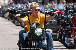 Paul and Suzy Yaffe ride down Maui Street during the annual Sturgis Black Hills Motorcycle Rally.  SD, USA.  August 7, 2016.  Photography ©2016 Michael Lichter.