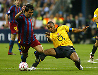 Photo: Chris Ratcliffe.<br /> Arsenal v Barcelona. UEFA Champions League Final. 17/05/2006.<br /> Thierry Henry stops Deco.