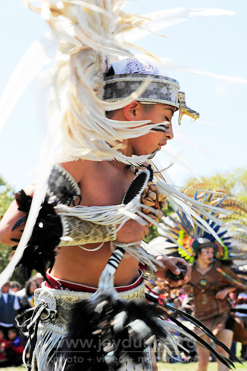 Natividad Creek Park in Salinas was the site for this Yaocuauhtli - Eagle Warrior performance of more than twenty dancers in full regalia. Participants of all ages like young Eduardo Rubio have to be in supreme physical condition, as ceremonies can last many hours, often in full sun.
