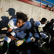 11/8/14 5:01:34 PM -- Grossmont College Wide Reciever, Javon Haston (11) sits on the side lines between plays in a game against the Santa Ana Dons at Santa Ana Stadium in Santa Ana, Calif., on Saturday, November 8, 2014. Grossmont College won the game with a score of 23-30. (© Mischa Lopiano 2014)