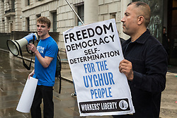 Activists from Uyghur Solidarity Campaign UK and other supporting groups protest opposite the Chinese embassy in support of the Uyghur people's struggle for freedom on 5th August 2021 in London, United Kingdom. Activists highlighted the Chinese government's persecution and forced assimilation of Uyghurs, Kazakhs and other indigenous people in East Turkestan and Xinjiang and called for them to have the right to determine their own futures through a democratic process.