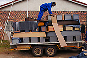 At Lesotho Funeral Services, coffins are delivered and placed inside the building. The bodies are then placed inside the coffin and prepared for burial. Because of the AIDS Pandemic, he funeral services business is one of the fastest growing in Africa.