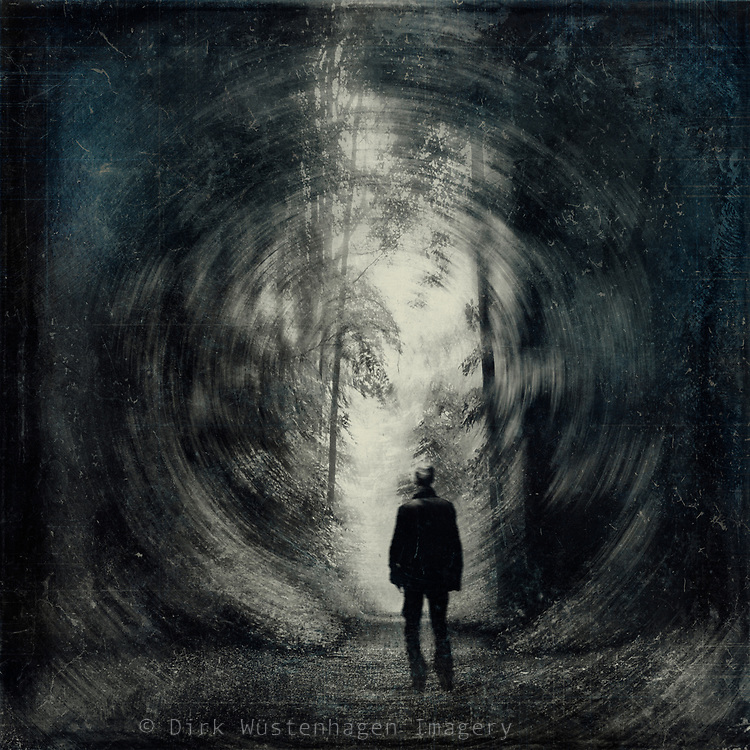 Man walking a forest path - abstract photograph