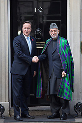 © licensed to London News Pictures. London, UK 29/10/2013. Prime minister David Cameron meeting with Afghan President Hamid Karzai in Downing Street, London for trilateral talks with Pakistani Prime minister Nawaz Sharif. Photo credit: Tolga Akmen/LNP