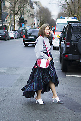 March 4, 2018 - Paris, France - A guest is seen on the street attending Valentino during Paris Women's Fashion Week A/W 2018 wearing a grey sweater with navy plaid skirt on March 4, 2018 in Paris, France. (Credit Image: © Nataliya Petrova/NurPhoto via ZUMA Press)